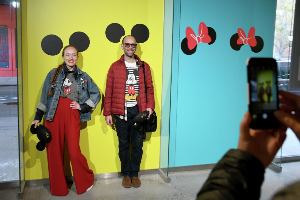 Visitors of an exhibition celebrating Mickey Mouse's 90th anniversary in New York.