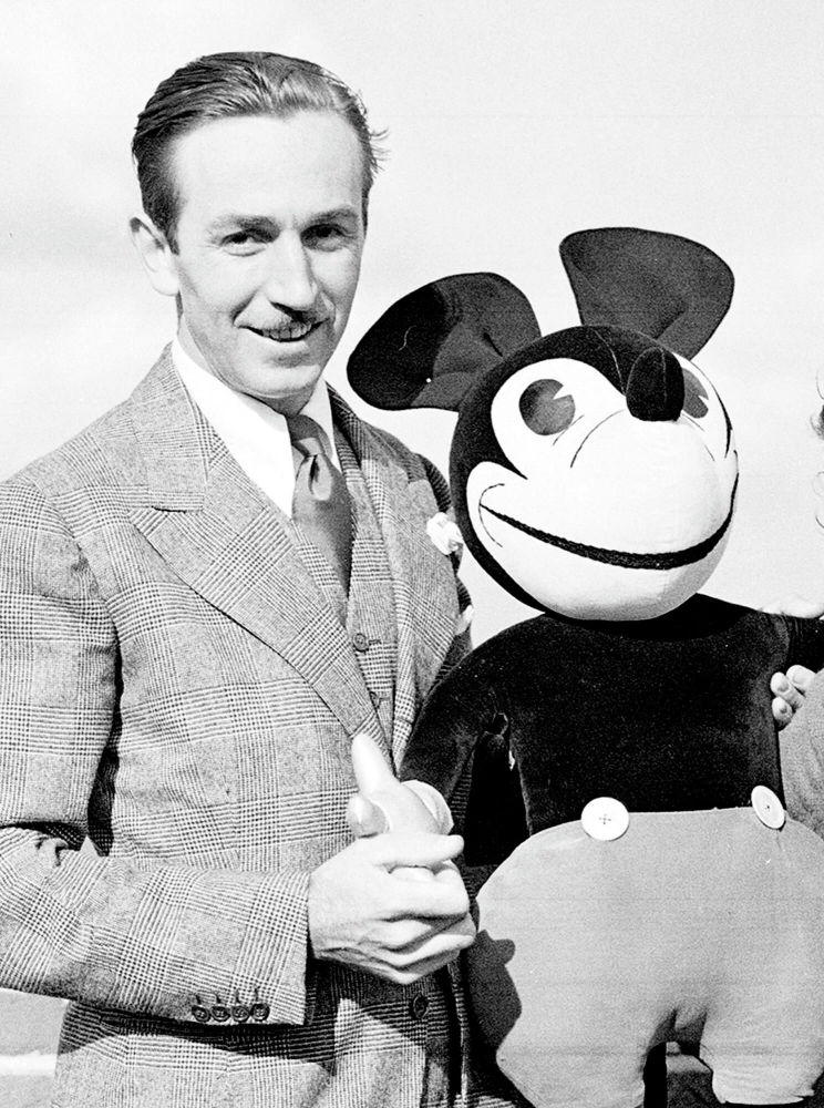 Mickey Mouse's creator Walt Disney with a Mickey doll, London.