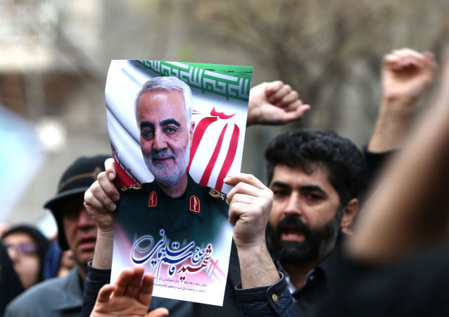Iranian demonstrators chant slogans during a demonstration decrying the assassination of Iranian Major-General Qassem Soleimani, head of the elite Quds Force, and Iraqi militia commander Abu Mahdi al-Muhandis, who were killed in a US air strike on Baghdad airport, in front of United Nation office in Tehran, Iran, 3 January 2020.