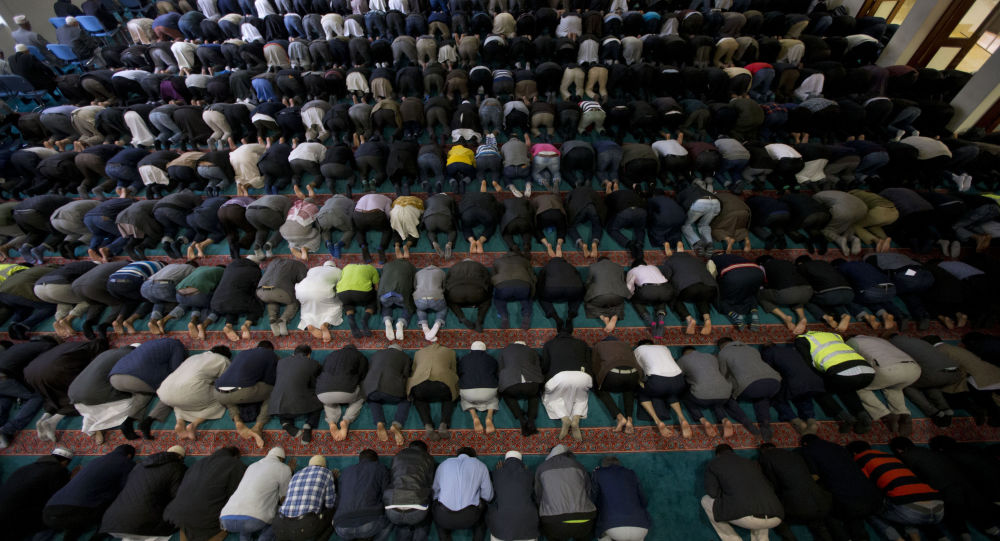In this Sept. 15, 2015 photo, men take part in prayers at the 7,000 worshipper capacity East London Mosque in east London, the largest mosque in the United Kingdom.