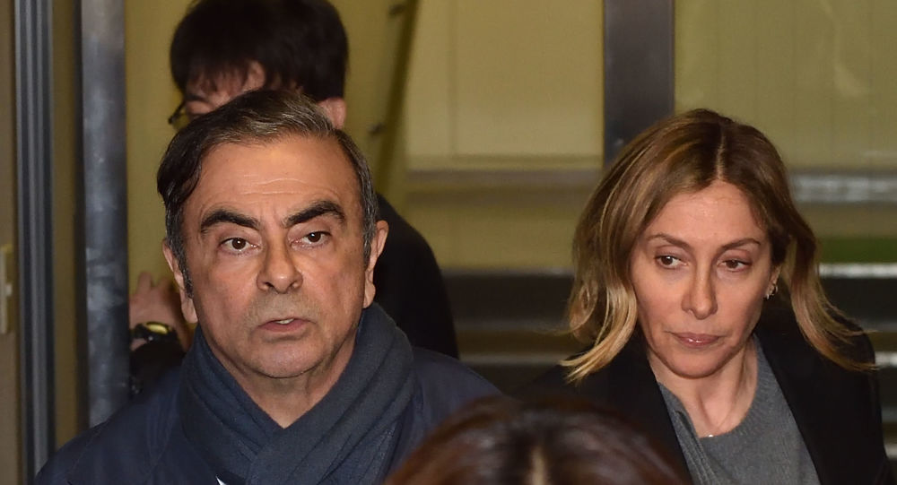 In this file photo taken on April 3, 2019, former Nissan Chairman Carlos Ghosn (L) and his wife Carole (R) leave the office of his lawyer in Tokyo.