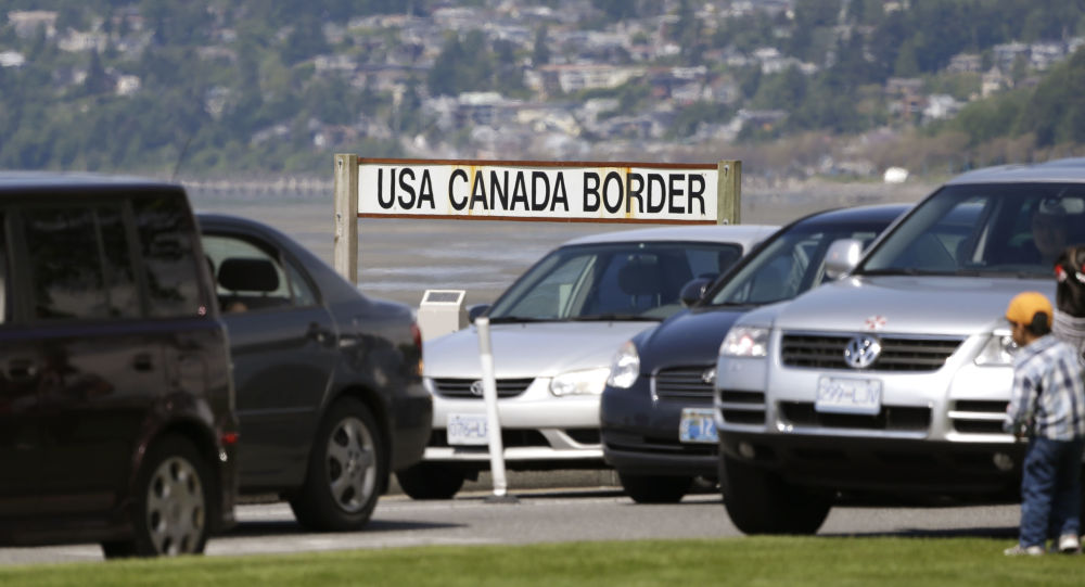 Cars from Canada line up to cross into the U.S. in Blaine
