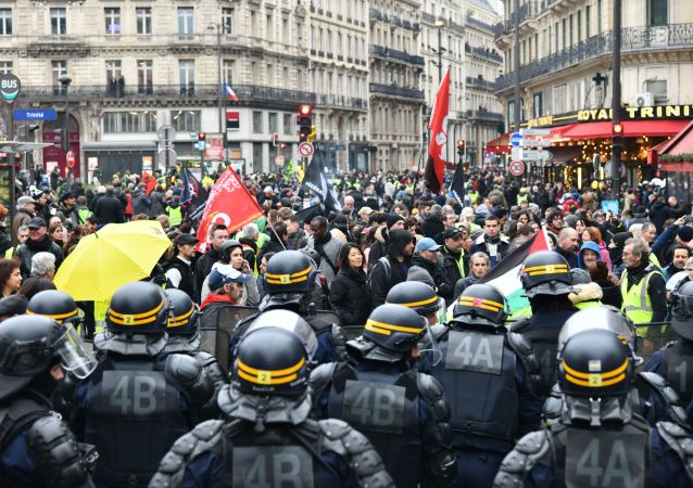 Protesters face off with CRS riot police during a demonstration as part of the 36th consecutive day of strike against French government's pensions reform plans, in Paris, France. The legal retirement age in France will remain 62 with the new French retirement plan, but workers will need to work until 64 to get a full pension, French Prime Minister Edouard Philippe announced shortly before Christmas.