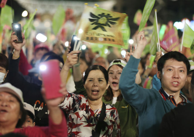 Supporters of Taiwan's 2020 presidential election candidate, Taiwan president Tsai Ing-wen of the Democratic Progressive Party (DPP), cheer during a campaign rally in Taipei, Taiwan, Friday, Jan. 10, 2020. Taiwan will hold its presidential election on Jan. 11, 2020. (AP Photo/Chiang Ying-ying)