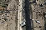 Rescue workers search the scene where a Ukrainian plane crashed in Shahedshahr, southwest of the capital Tehran, Iran