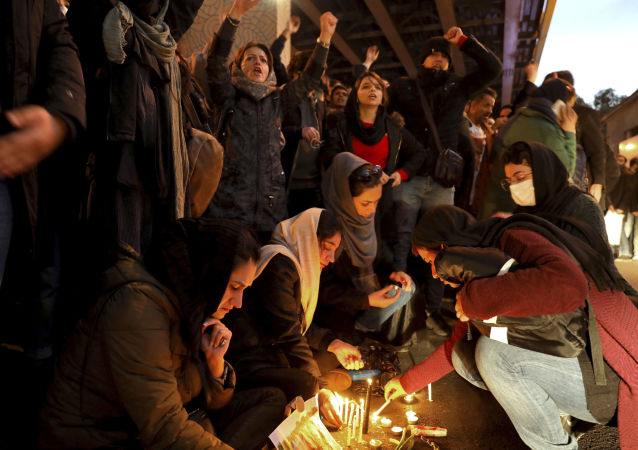 People gather for a candlelight vigil to remember the victims of the Ukraine plane crash, at the gate of Amri Kabir University, which some of the victims of the crash were former students of, in Tehran, Iran, on Saturday, 11 January 2020. On that day, Iran acknowledged that its armed forces unintentionally shot down the Ukrainian jetliner that crashed earlier this week, killing all 176 aboard, after the government had repeatedly denied Western accusations that it was responsible.