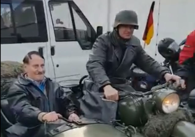 A Hitler look-alike is filmed sitting in a motorcycle sidecar in a video posted to Twitter on Monday, 13 January