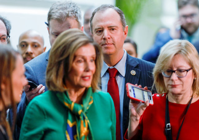 House Intelligence Committee Chairman Adam Schiff (D-CA) and House Speaker Nancy Pelosi (D-CA) are followed by reporters after a House Democratic Caucus meeting to discuss transmitting the articles of impeachment against U.S. President Donald Trump to the Senate at the U.S. Capitol in Washington, U.S., January 14, 2020