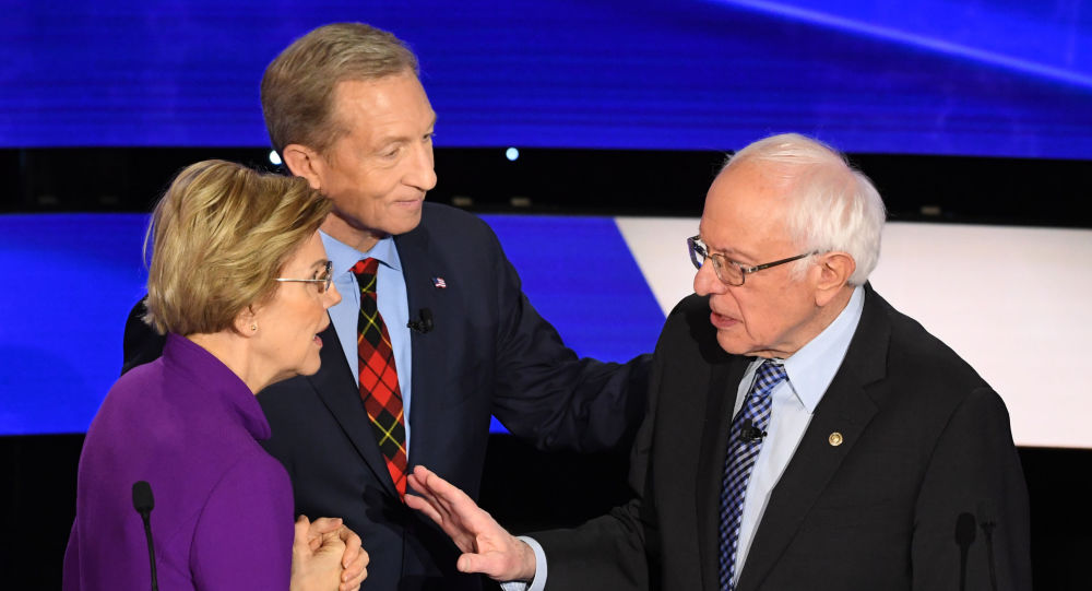 Three Democratic presidential hopefuls: Massachusetts Senator Elizabeth Warren, billionaire-philanthropist Tom Steyer (C) and Vermont Senator Bernie Sanders speak after the seventh Democratic primary debate of the 2020 presidential campaign, season co-hosted by CNN and the Des Moines Register at the Drake University campus in Des Moines, Iowa on 14 January 2020.