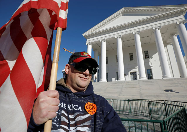 Gun rights activist James Davis, 43 and from King George, Virginia, demonstrates outside the Virginia State Capitol building as the General Assembly prepares to convene in Richmond, Virginia, U.S. January 8, 2020.