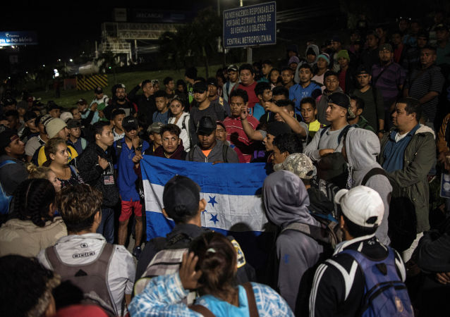 Hondurans gather to depart in a new caravan of migrants, set to head to the United States, in San Pedro Sula, Honduras January 15, 2020.