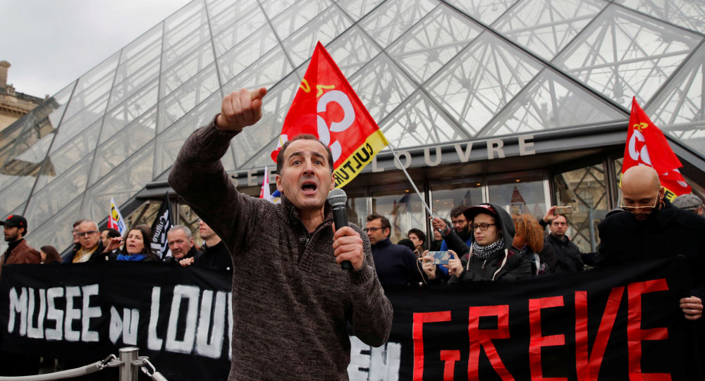 Striking workers block the entry at the glass Pyramid of the Louvre museum in Paris as France faces its 44th consecutive day of strikes January 17, 2020
