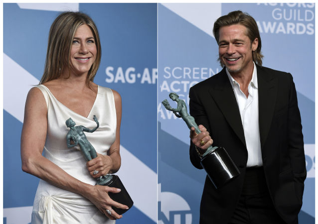 This combination photo shows Jennifer Aniston with the award for outstanding performance by a female actor in a drama series for The Morning Show, left, and Brad Pitt with the award for outstanding performance by a male actor in a supporting role for Once Upon a Time in Hollywood at the 26th annual Screen Actors Guild Awards at the Shrine Auditorium & Expo Hall on Sunday, 19 January 2020, in Los Angeles. (Photos by Jordan Strauss/Invision/AP)