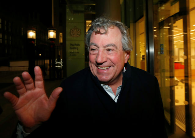 FILE PHOTO: British comedian Terry Jones smiles as he leaves The Rolls Building in central London November 30, 2012