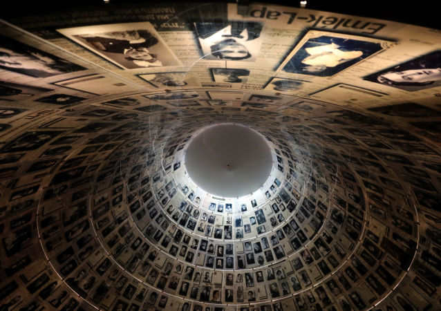 A view from below shows pictures of Jews killed in the Holocaust displayed at the Hall of Names in the Holocaust History Museum at the Yad Vashem World Holocaust Remembrance Centre in Jerusalem, 15 January 2020