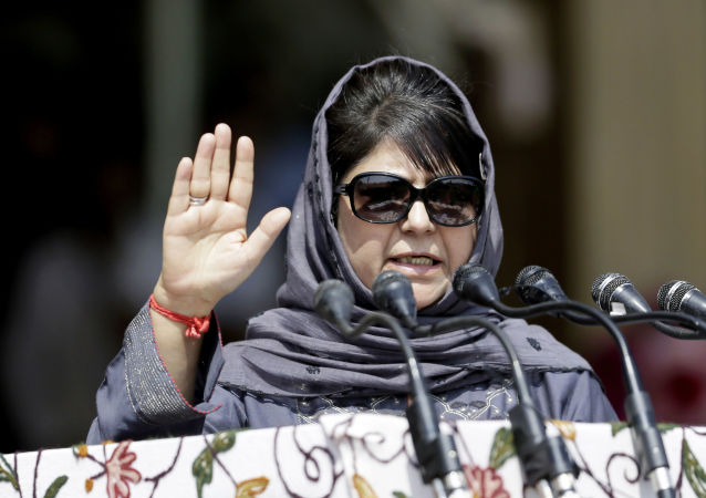 Jammu and Kashmir state Chief Minister Mehbooba Mufti speaks during an Independence Day parade in Srinagar, Indian controlled Kashmir, Tuesday, Aug. 15, 2017