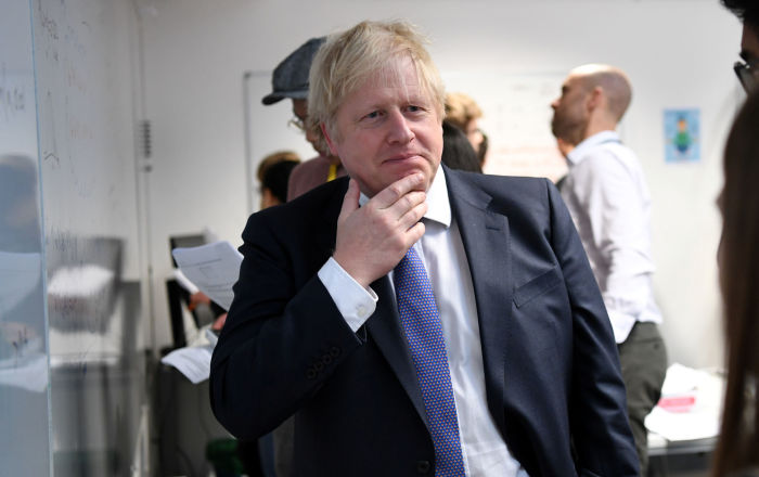 Britain's Prime Minister Boris Johnson reacts as he listens to students solving maths questions during his visit to the Department of Mathematics at King's Maths School, part of King's College London University, in central London, Britain January 27, 2020