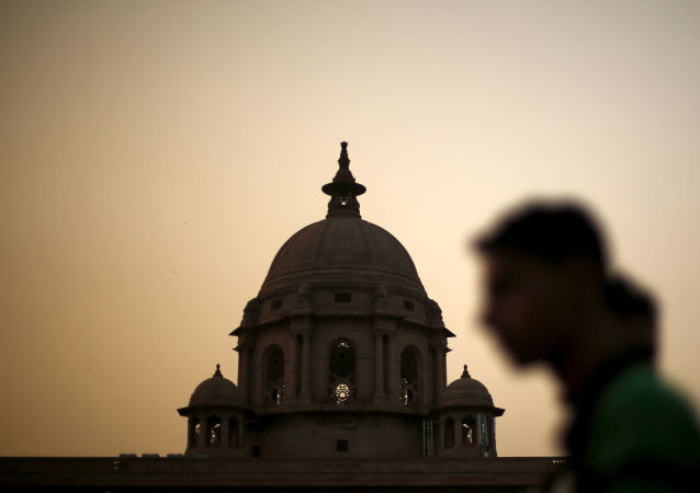 FILE PHOTO: A commuter walks past the building of India's Ministry of Finance during dusk in New Delhi, India, May 18, 2015.