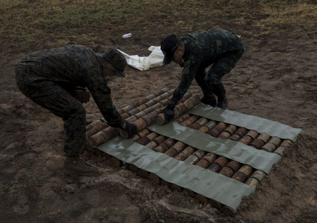 U.S. Marine Corps Staff Sgt. Kevin Syphanthavong and a Royal Thai explosive ordnance disposal technician stage old anti-personnel mines for detonation on an explosives range in the Kingdom of Thailand during Cobra Gold 19 Feb. 18, 2019. U.S. Marines assist the Royal Thai Armed Forces in teaching explosive ordnance disposal courses and disposing landmines. Syphanthavong, an EOD technician with 3rd EOD Company, 9th Engineer Support Battalion, is a native of Lynn, Massachussettes.
