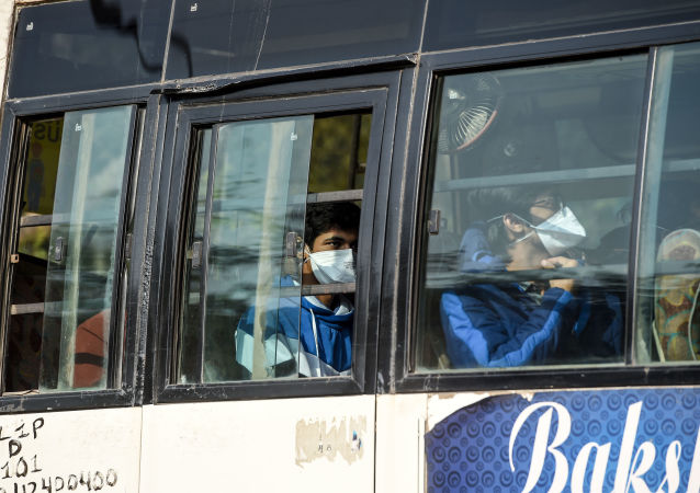 Indian nationals are transported in a bus out of the Indira Gandhi International Airport following their evacuation from the Chinese city of Wuhan, in New Delhi on February 1, 2020.