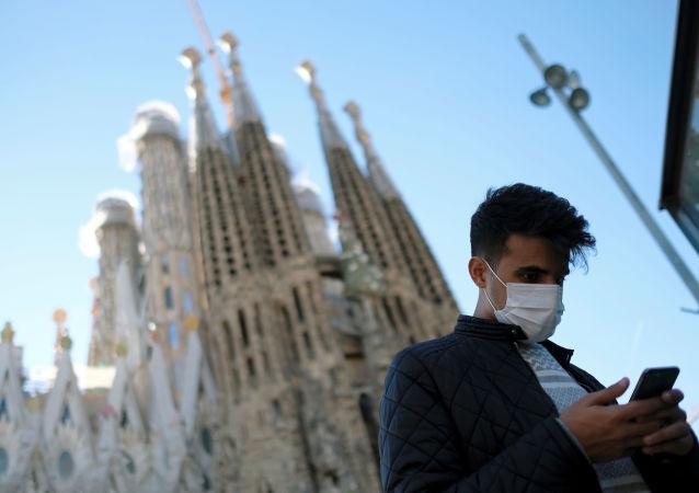 Tourist Wearing Protective Mask in Front of Basilica Sagrada Familia, Barcelona