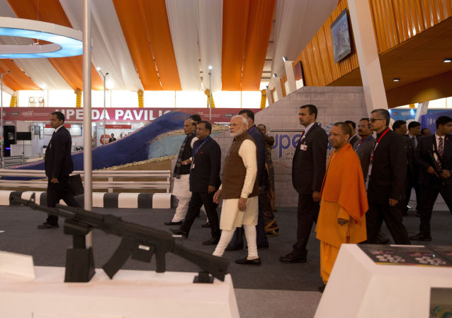 Indian Prime Minister Narendra Modi, center, and Chief Minister of Uttar Pradesh state Yogi Adityanath, in saffron, attend the DefExpo in Lucknow, India, Wednesday, Feb. 5, 2020