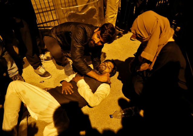A student is assisted after he was injured during a scuffle with police at a protest against a new citizenship law outside the Jamia Millia Islamia University in New Delhi, India January 30, 2020