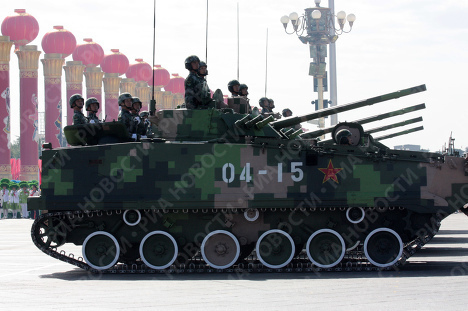 China marks 60th anniversary with tanks and female air regiment
