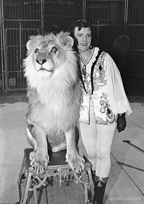 Animal tamer Irina Bugrimova with lions at her feet