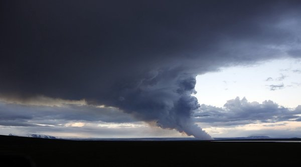 A plume of smoke rises from the lava eruption on Holuhraun, northwest of the Dyngjujoekull glacier in Iceland