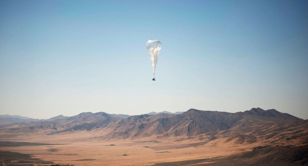 A Loon internet balloon, carrying solar-powered mobile networking equipment over the company's launch site in Winnemucca, Nevada. The balloons started delivering internet access to Kenya on Tuesday