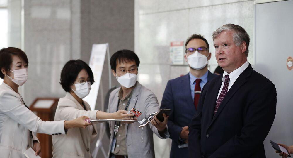 US Deputy Secretary of State Stephen Biegun speaks to the media beside his South Korean counterpart Lee Do-hoon after their meeting at the Foreign Ministry in Seoul on July 8, 2020.