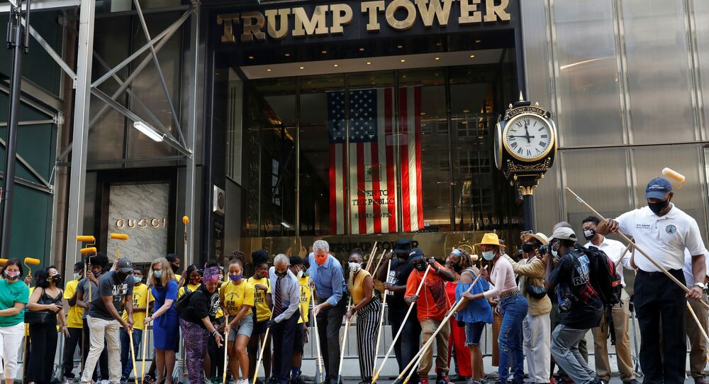 Black Lives Matter in Front of Trump Tower Painted Over in Red
