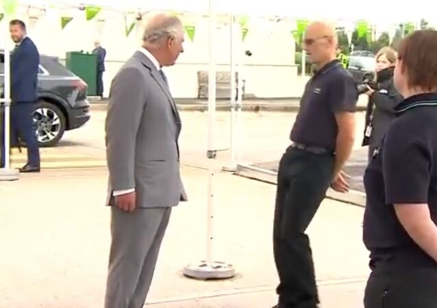An employee faints in front of Prince Charles at a distribution centre in Bristol
