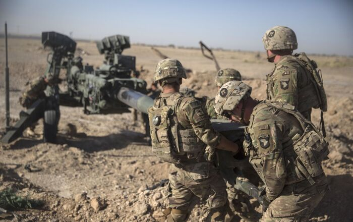 This June 10, 2017 photo provided by Operation Resolute Support, U.S. Soldiers with Task Force Iron maneuver an M-777 howitzer, so it can be towed into position at Bost Airfield, Afghanistan