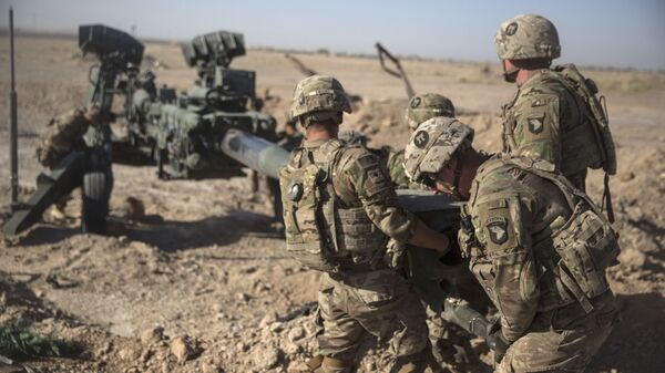 This June 10, 2017 photo provided by Operation Resolute Support, U.S. Soldiers with Task Force Iron maneuver an M-777 howitzer, so it can be towed into position at Bost Airfield, Afghanistan - Sputnik International