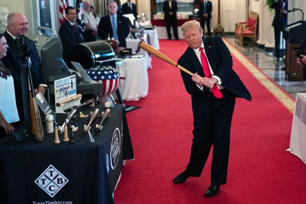 President Donald Trump swings a baseball bat during the Spirit of America Showcase at the White House, Thursday, 2 July 2020, in Washington. - Sputnik International