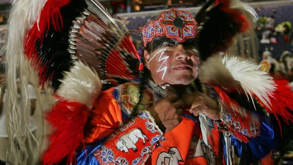 Native American Dwight White Buffalo, a Cheyenne from Watonga, Oklahoma, prepares for the opening of the National Pow Wow 12 August 2005 at the MCI Center in Washington, DC - Sputnik International