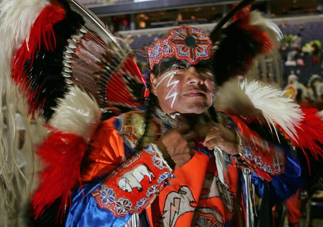 Native American Dwight White Buffalo, a Cheyenne from Watonga, Oklahoma, prepares for the opening of the National Pow Wow 12 August 2005 at the MCI Center in Washington, DC