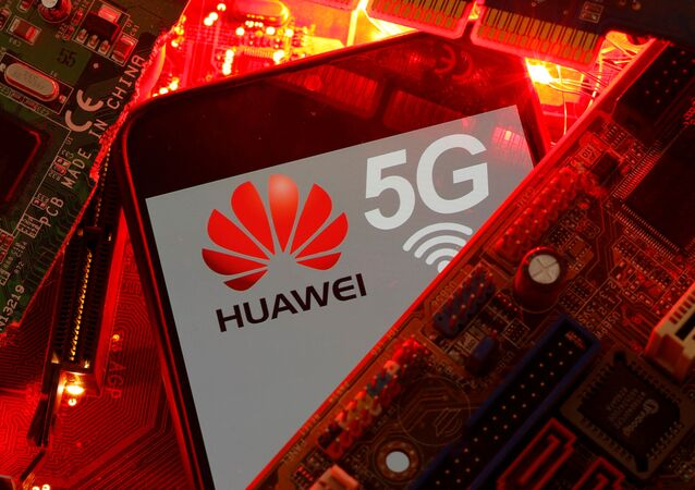 A smartphone with the Huawei and 5G network logo is seen on a PC motherboard in this illustration picture taken January 29, 2020
