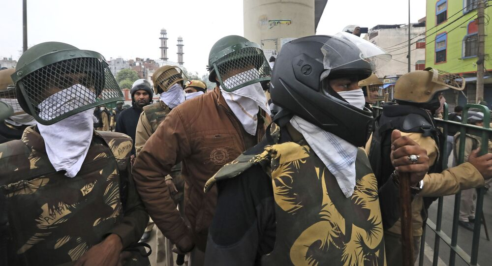 Indian Policemen cover their faces with their handkerchiefs (File)