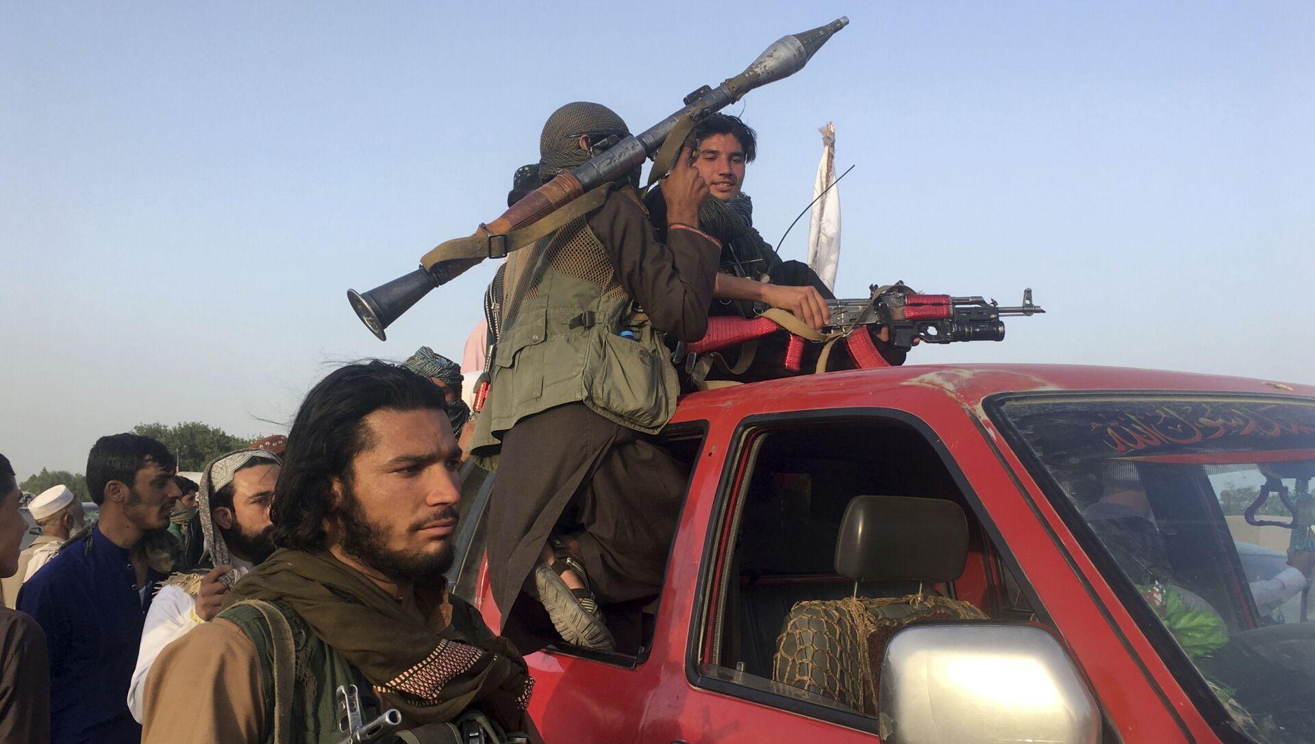 Taliban fighters ride in their vehicle in Surkhroad district of Nangarhar province, east of Kabul, Afghanistan, Saturday, June 16, 2018 - Sputnik International, 1920, 24.07.2021