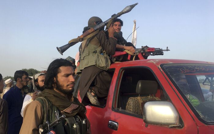Taliban fighters ride in their vehicle in Surkhroad district of Nangarhar province, east of Kabul, Afghanistan, Saturday, June 16, 2018
