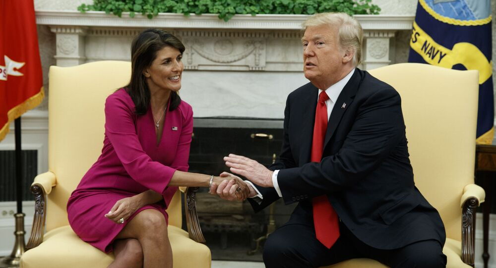 President Donald Trump meets with outgoing US Ambassador to the United Nations Nikki Haley in the Oval Office of the White House, Tuesday, 9 October 2018, in Washington