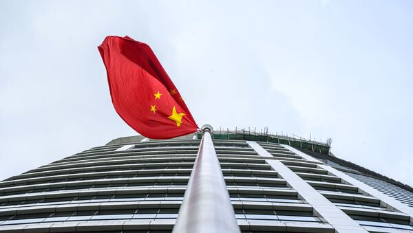 A Chinese flag flutters outside the Office for Safeguarding National Security of the Central People's Government in the Hong Kong Special Administrative Region after its official inauguration in Hong Kong on July 8, 2020 - Sputnik International