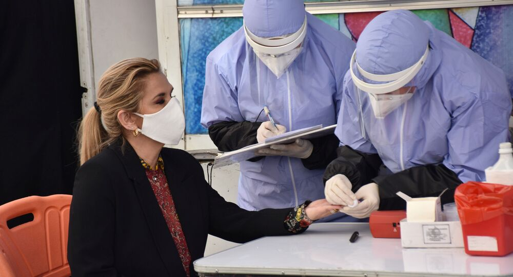 Healthcare workers conduct a blood test on Bolivia's Interim President Jeanine Anez during the World Blood Donor Day campaign at the presidential palace in La Paz, Bolivia, June 12, 2020.