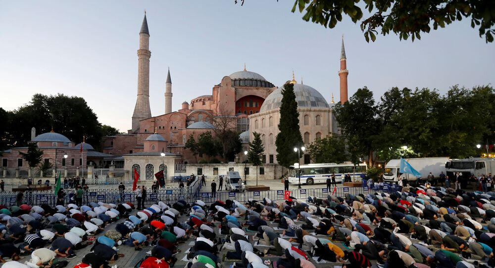 Muslims gather for evening prayers in front of the Hagia Sophia or Ayasofya in Istanbul