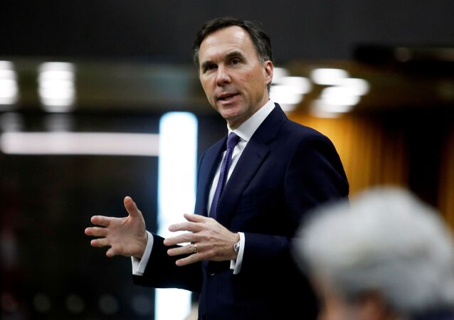 Canada's Minister of Finance Bill Morneau speaks in the House of Commons as legislators convene to give the government power to inject billions of dollars in emergency cash to help individuals and businesses through the economic crunch caused by the coronavirus disease (COVID-19) outbreak, on Parliament Hill in Ottawa, Ontario, Canada April 11, 2020.