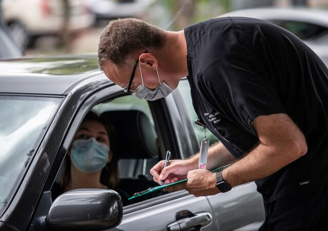 Ella Speer speaks with a doctor before getting tested in for the coronavirus disease (COVID-19) during an outbreak in Austin, Texas, U.S., June 28, 2020.