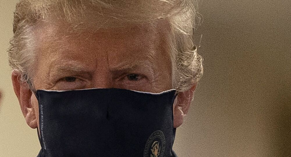U.S. President Donald Trump wears a mask while visiting Walter Reed National Military Medical Center in Bethesda, Maryland, U.S., July 11, 2020.